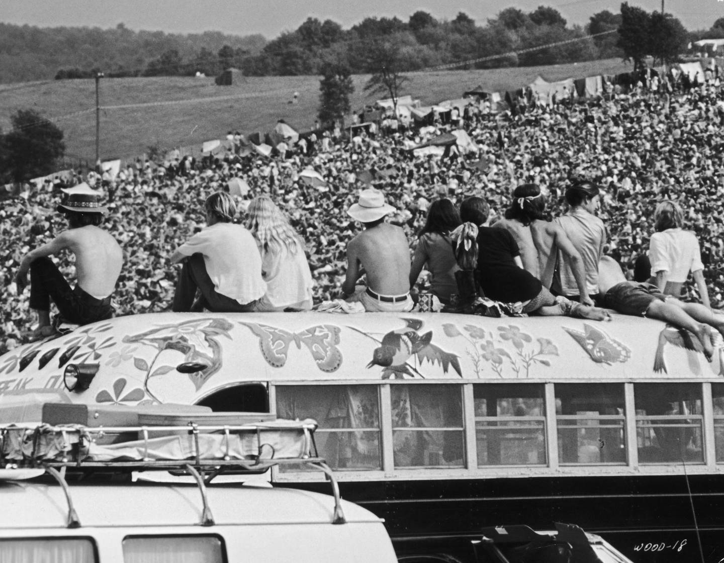 Fans sitting on top of a painted bus at the Woodstock Music Festival, Bethel, New York, 15th-17th August 1969. (Photo by Archive Photos/Getty Images)