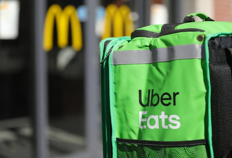 An Uber Eats food delivery courier's backpack is seen in from of a fast food restaurant as the spread of coronavirus disease (COVID-19) continues in Amsterdam, Netherlands March 25, 2020. REUTERS/Eva Plevier