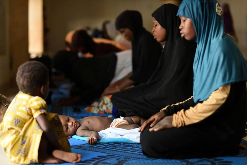 A girl lies down as women pray at a mosque during the holy month of Ramadan, amid the spread of the coronavirus disease (COVID-19) in Ouagadougou, Burkina Faso May 3, 2020. REUTERS/Anne Mimault     TPX IMAGES OF THE DAY