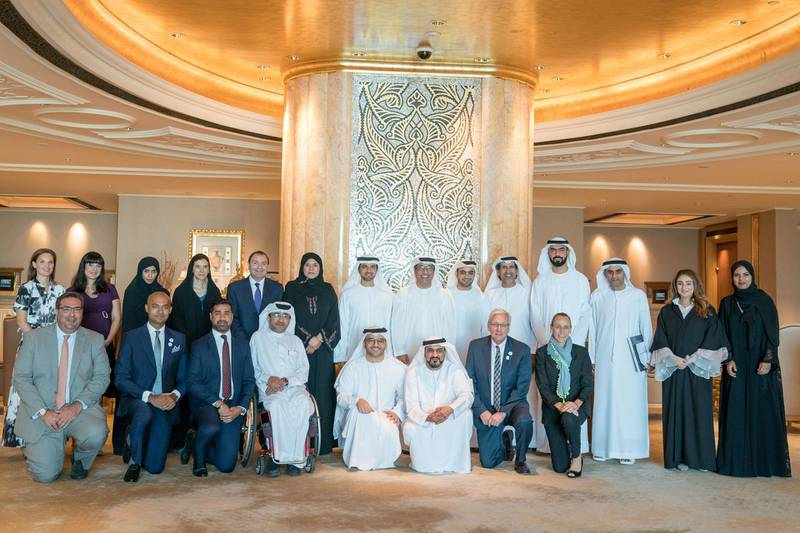 ABU DHABI, UNITED ARAB EMIRATES - June 24, 2019: HE Mohamed Al Junaibi, Director of the President's Protocol Office at the UAE Ministry of Presidential Affairs and Chairman of the Special Olympics Higher Committee (back row, 7th R), stands for a group photo with members of the Higher Committee and Local Organizing Committee of the Special Olympics World Games Abu Dhabi 2019, at Emirates Palace. Seen with: Tala Al Ramahi, Chief Strategy Officer of the Special Olympics World Games Abu Dhabi 2019 (2nd R), HE Dr. Ali Bin Tamim Director General, Abu Dhabi Media (3rd R), HE Saif Ghobash Director General, Department of Tourism and Culture Abu Dhabi (4th R), HE Mohamed Fadel Al Hameli Chairman, UAE Disabled Sports Federation (5th R), Khalfan Al Mazroui, Managing Director of the Special Olympics World Games Abu Dhabi 2019 (6th R), HE Dr. Fahad Matar Al Neyadi Director General, General Secretariat of Executive Council (7th R), HE Sana Suhail Secretary General, Ministry of Community Development (8th R) and other dignitaries.   ( Mohamed Al Hammadi / Crown Prince Court - Abu Dhabi ) ---