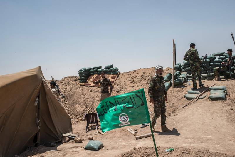 NINEVEH, IRAQ - JUNE 20: Iraqi PMF fighters at their position June 20, 2017 on the Iraq-Syria border in Nineveh, Iraq. The Popular Mobilisation Front (PMF) forces, composed of majority Shi'ite militia, part of the Iraqi forces, have pushed Islamic State militants from the north-western Iraq border strip back into Syria. The PMF now hold the border, crucial to the fall of Islamic State in Mosul, blocking the Islamic State supply route for militants from Syria to Mosul. (Martyn Aim/Getty Images).