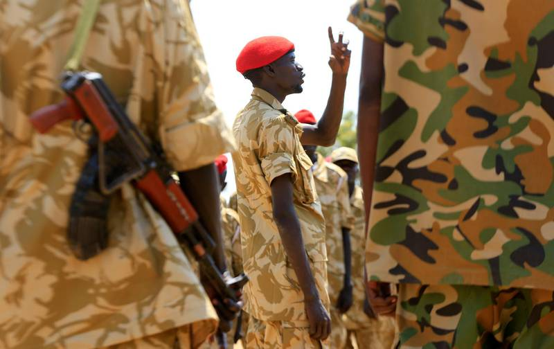 South Sudanese soldiers gather for a briefing at the army general headquarters in Juba, January 8, 2014. REUTERS/James Akena (SOUTH SUDAN - Tags: POLITICS CIVIL UNREST CONFLICT MILITARY)