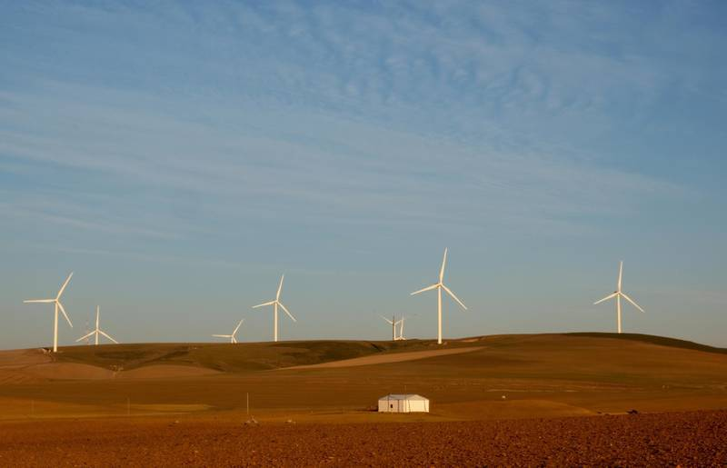 FILE PHOTO: Wind turbines produce renewable energy outside Caledon, South Africa, May 20, 2020. Picture taken May 20, 2020. REUTERS/Mike Hutchings/File Photo