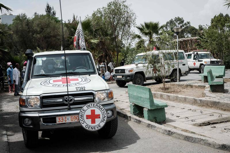 Ambulances of Red Cross arrive with patients who were injured in their town Togoga in a deadly airstrike on a market, arrive at Mekelle General Hospital in Mekele, on June 24, 2021, two days after a deadly airstrike on a market in Ethiopia's war-torn northern Tigray region, where a seven-month-old conflict surged again.  At least 64 people were killed and 180 were injured in an air strike on a market in Ethiopia's war-torn northern Tigray region, a local health officer said, as the army denied targeting civilians. / AFP / Yasuyoshi CHIBA
