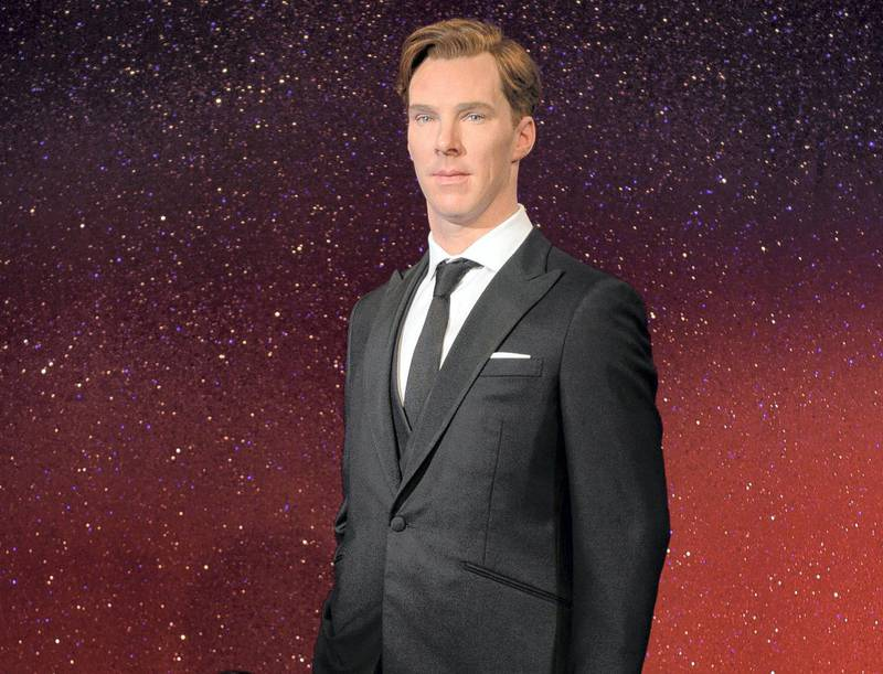 """Stylists Claire Galvin (L) poses with the new wax figure of British actor Benedict Cumberbatch as it is unveiled at Madame Tussauds in central London on October 21, 2014. Dressed in a dark suit the figure of Cumberbatch has been modelled to be """"premiere ready"""".  AFP PHOTO / LEON NEAL (Photo by LEON NEAL / AFP)"""