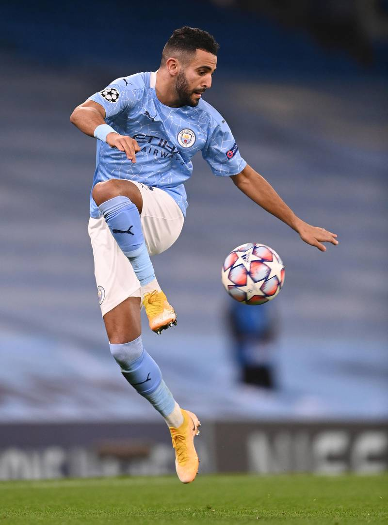 MANCHESTER, ENGLAND - OCTOBER 21: Riyad Mahrez of Manchester City jumps to control the ball during the UEFA Champions League Group C stage match between Manchester City and FC Porto at Etihad Stadium on October 21, 2020 in Manchester, England. Sporting stadiums around the UK remain under strict restrictions due to the Coronavirus Pandemic as Government social distancing laws prohibit fans inside venues resulting in games being played behind closed doors. (Photo by Laurence Griffiths/Getty Images)