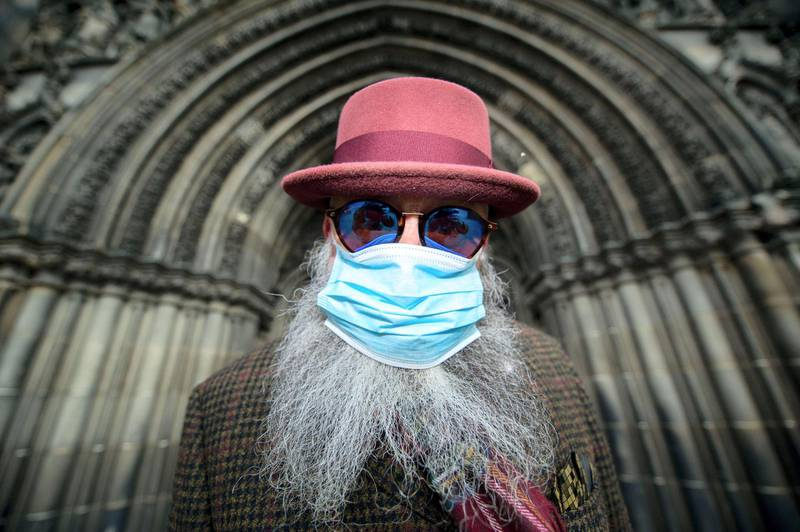 2B744MX Edinburgh, UK. 13th Mar, 2020. Pictured: Man seen wearing surgical mask and covering his nose and mouth due to the Coronavirus pandemic. Credit: Colin Fisher/Alamy Live News