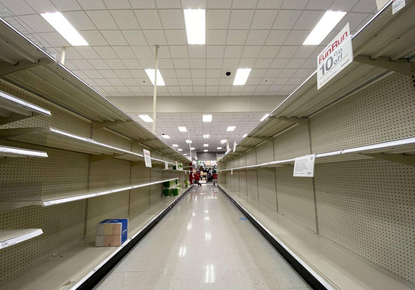 ARLINGTON, VIRGINIA - MARCH 13: Shelves normally stocked with hand wipes, hand sanitizer and toilet paper sit empty at a Target store as people stockpile supplies due to the outbreak of the coronavirus (COVID-19) March 13, 2020 in Arlington, Virginia. The U.S. government is racing to make more coronavirus test kits available as schools close around the country, sporting events are canceled, and businesses encourage workers to telecommute where possible.   Win McNamee/Getty Images/AFP == FOR NEWSPAPERS, INTERNET, TELCOS & TELEVISION USE ONLY ==