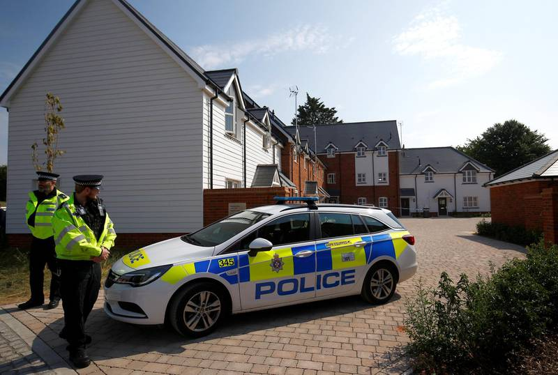 Police officers guard the entrance to a housing estate on Muggleton Road, after it was confirmed that two people had been poisoned with the nerve-agent Novichok, in Amesbury, Britain, July 5, 2018. REUTERS/Henry Nicholls