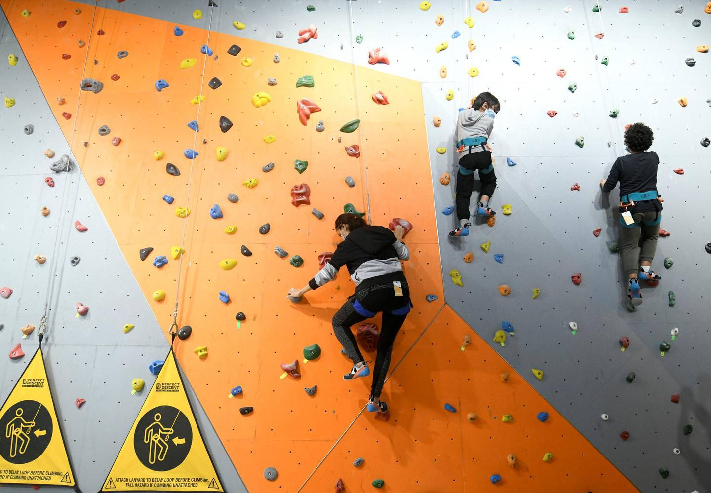 Abu Dhabi, United Arab Emirates - The family scales the indoor climbing walls together at CLYMB, Yas Island. Khushnum Bhandari for The National