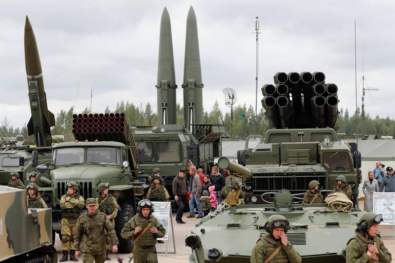 epa07108049 (FILE) - Visitors look at Russian tactical ballistic missile OTR-21 Tochka-U (L), 122mm multiple rocket launcher BM-21 Grad (2_L), tactical ballistic missile 9K720 Iskander-M (C) and 300mm multiple rocket launcher BM-30 Smerch (R) during a military exhibition marking the Tank's Day on a tank range in Luga, outside St. Petersburg, Russia, 09 September 2017 (reissued 20 October 2018). According to media reports, the Trump administration has told US allies that it wants to withdraw from the landmark Reagan-era Intermediate-range Nuclear Forces Treaty, or INF.