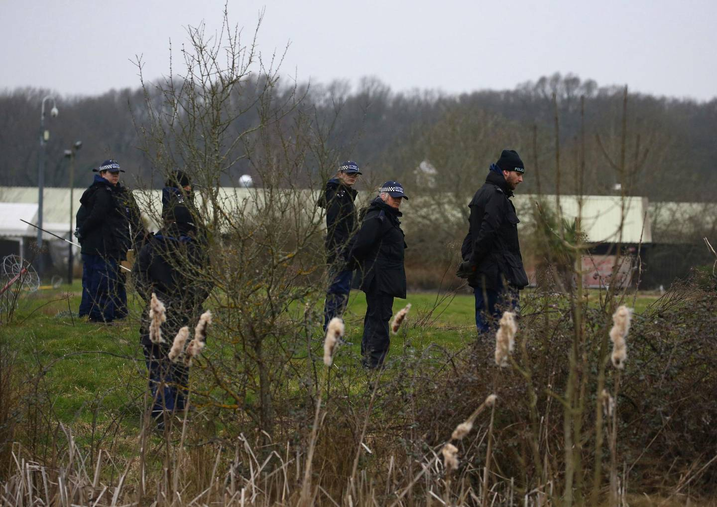 """Officers from the Metropolitan Police search land near to Great Chart Golf and Lesiure, in connection with the disappearance of Sarah Everard, in Ashford, England, Wednesday March 10, 2021. Britain's Metropolitan police says an officer has been arrested in connection with the case of a woman who went missing in London last week. The force said the fact that the man is a serving police officer is """"shocking and deeply disturbing."""" Police said the officer was arrested late Tuesday in Kent, southeast of London, as part of the investigation into the disappearance of Sarah Everard. (Gareth Fuller /PA via AP)"""