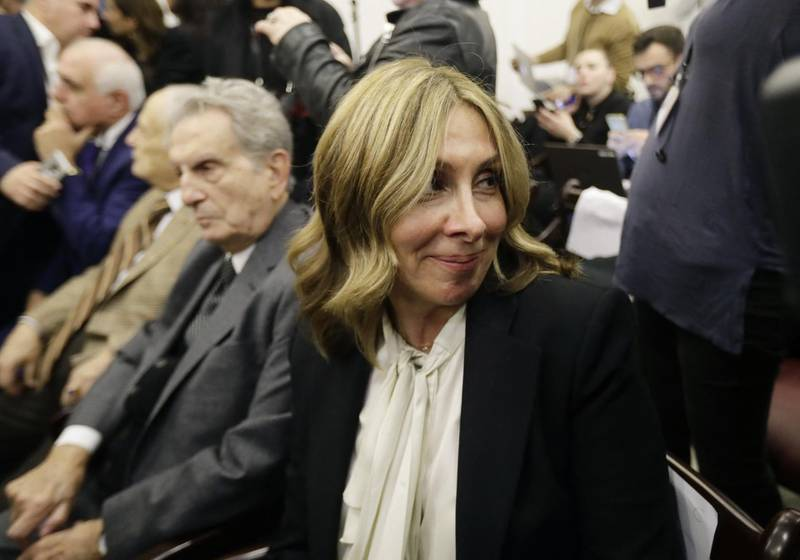 Carole, the wife of former Renault-Nissan boss Carlos Ghosn, looks emotional during a press conference in which her husband addressed a large crowd of journalists on his reasons for dodging trial in Japan, where he is accused of financial misconduct, at the Lebanese Press Syndicate in Beirut on January 8, 2020. - The 65-year-old fugitive auto tycoon vowed to clear his name as he made his first public appearance at a news conference in Beirut since skipping bail in Japan. Carlos Ghosn, who denies any wrongdoing, fled charges of financial misconduct including allegedly under-reporting his compensation to the tune of $85 million. (Photo by JOSEPH EID / AFP)