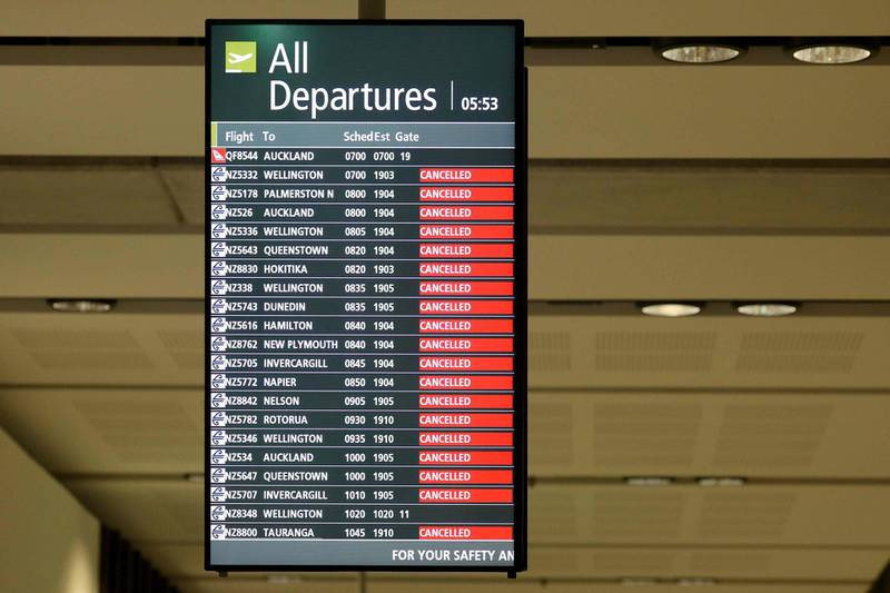 A signboard shows cancelled flights at the departures areaat Christchurch Airport in Christchurch on April 8, 2020. New Zealand is on lockdown for a four-week period that started on March 25 to avoid the spread of the COVID-19 coronavirus. / AFP / Sanka VIDANAGAMA