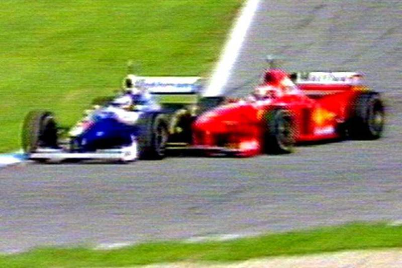 German Michael Schumacher's Ferrari crashes into the left side of Canadian Jacques Villeneuve's William-Renault 26 October during the season-ending European Formula One Grand Prix in Jerez. Schumacher was forced to quit the race following the accident. Villeneuve won the driver's world champion title after placing third behind winner Mika Hakkinen of Finland on McLaren-Mercedes and his second-placed teammate David Coulthard of Scotland.
