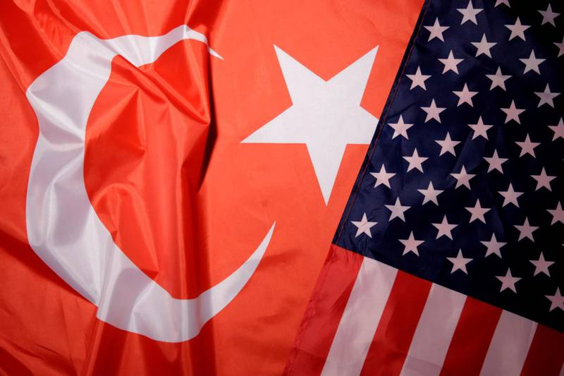 FILE PHOTO: Turkey and U.S. flags are seen in this picture illustration taken August 25, 2018. Picture taken August 25, 2018. REUTERS/Dado Ruvic/Illustration/File Photo