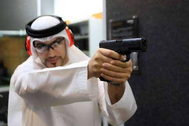 10 AUGUST 2010 - Abu Dhabi - Ali humaid Al Nuaimi, shooter practicing his shooting skilss with a pistol at Caracal shoot club at Armed Forces Officers club in Abu Dhabi. Ravindranath K / The National     For a Business weekend package by Gregor Stuart Hunter