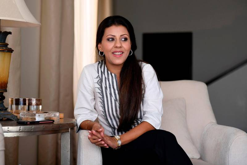 """Nouf Marwaai, 38, the head of the Arab Yoga Foundation, smiles as she poses in the western Saudi Arabian city of Jeddah on September 7, 2018. Widely perceived as a Hindu spiritual practice, yoga was not officially permitted for decades in Saudi Arabia, the cradle of Islam where all non-Muslim worship is banned. But with Crown Prince Mohammed bin Salman vowing an """"open, moderate Islam"""", the kingdom last November recognised yoga as a sport, despite the risk of riling hardliners opposed to the practice. / AFP / Amer HILABI"""