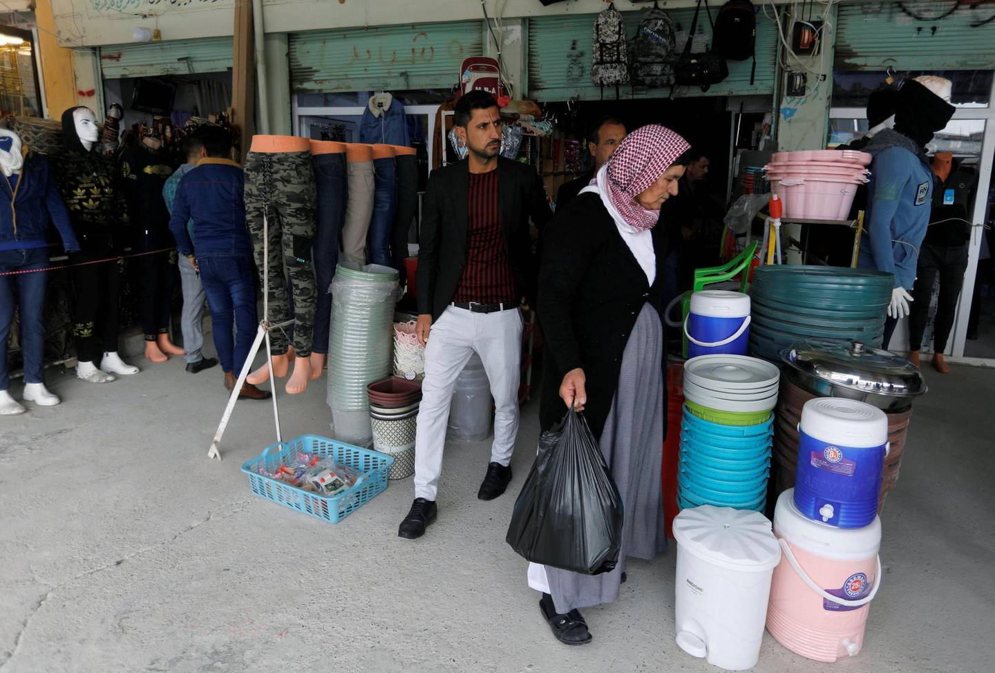 People from the minority Yazidi sect shop at a market in Sinjar, Iraq December 1, 2020. REUTERS/Khalid al-Mousily