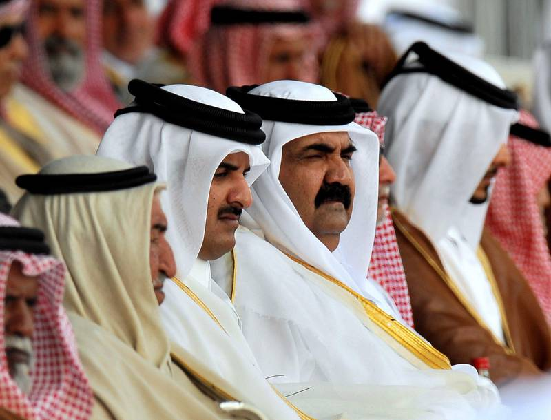 epa01969553 Emir of Qatar Hamad bin Khalifa al-Thani (C-R) and Crown Prince of Qatar Sheikh Tamim  Bin Hamad Al-Thani (C -L) attend a military parade at the Doha Corniche  to mark the Qatar National Day on 18 December 2009.On the 18th of December, Qatar celebrates its National Day in commemoration of the historic day in 1878 when Shaikh Jasim, the founder of the State of Qatar,succeeded his father, Shaikh Muhammad Bin Thani, as a ruler and led the country toward unity.  EPA/STR *** Local Caption ***  01969553.jpg