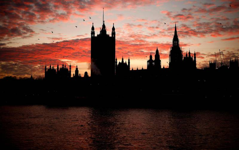(FILES) In this file photo taken on December 08, 2020 The sun sets behind the Victoria Tower at the Palace of Westminster, home to the Houses of Parliament, in London. According to a British government source a 'deal is done' on post-Brexit trade. / AFP / Tolga Akmen