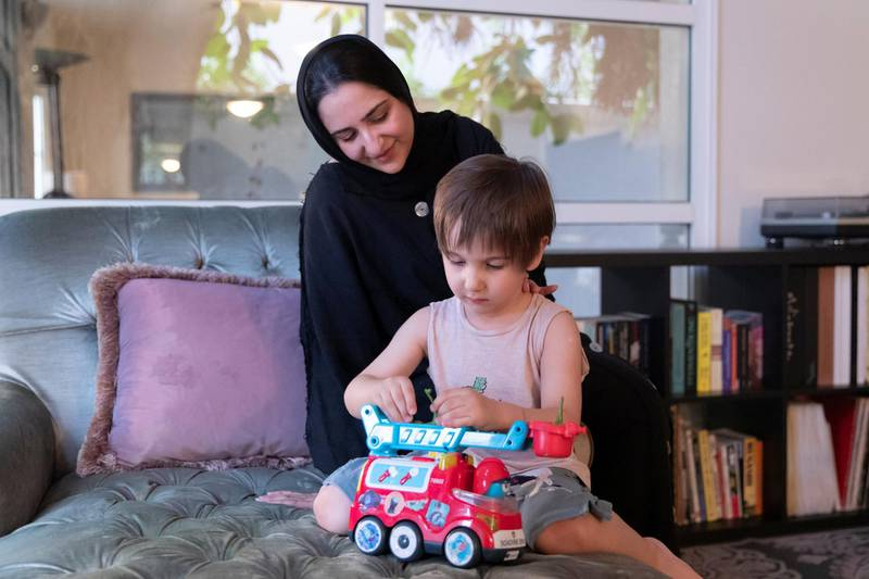 DUBAI, UNITED ARAB EMIRATES - OCTOBER 17, 2018. Esmat Rabi, with her son Abdullah.(Photo by Reem Mohammed/The National)Reporter: ANNA ZACHARIASSection:  NA