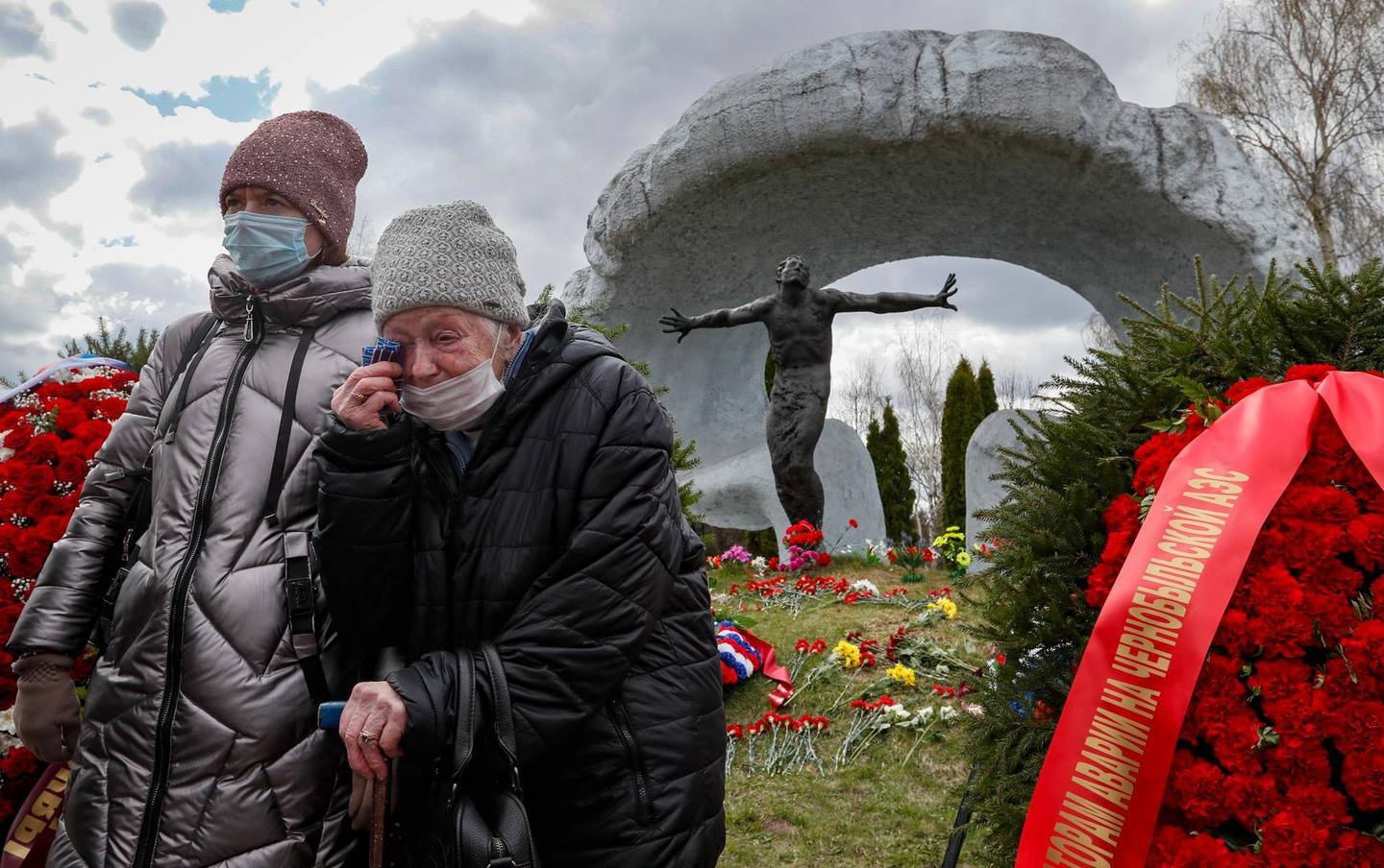 epa09161776 Women mourn near a tomb of a victim of the Chernobyl nuclear power plant disaster at the Mitino cemetery in Moscow, Russia, 26 April 2021, on the 35th anniversary of the tragedy. The explosion of reactor 4 of the Chernobyl nuclear power plant in the early hours of 26 April 1986 is still regarded as the worst nuclear disaster to date.  EPA/YURI KOCHETKOV