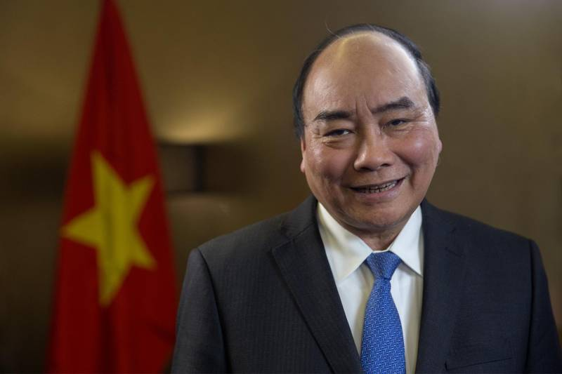 Nguyen Xuan Phuc, Vietnam's prime minister, poses for a photograph following a Bloomberg Television interview in Hanoi, Vietnam, on Thursday, Jan. 18, 2019. A red-hot economy, business-friendly policies and a Communist party led by free-traders: that's the elevator pitch Phucis delivering to global investors amid the U.S.-China trade war. Photographer: Maika Elan/Bloomberg