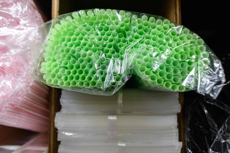 (FILES) In this file photo taken on May 21, 2018 straws are kept in plastic packaging in a plastics goods store in Hong Kong. In a milestone for environmentalists, Seattle has become the first major US city to ban plastic straws and utensils from its cafes and restaurants, but hopes of replicating the move nationwide still face mighty hurdles. / AFP / Anthony WALLACE