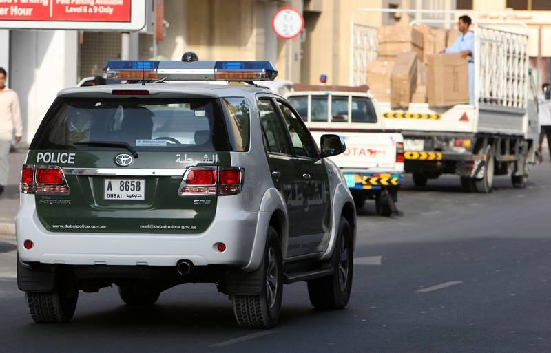DUBAI, UNITED ARAB EMIRATES – Sep 22: Police on Patrol on one of the road in Bur Dubai. (Pawan Singh / The National) *** Local Caption ***  PS004- POLICE.jpgPS004- POLICE.jpg