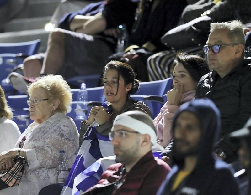 Abu Dhabi, United Arab Emirates - Reporter: Jon Turner: A Stefanos Tsitsipas fan clutches the Greek flag during the final between Rafael Nadal v Stefanos Tsitsipas at the Mubadala World Tennis Championship. Saturday, December 21st, 2019. Zayed Sports City, Abu Dhabi. Chris Whiteoak / The National