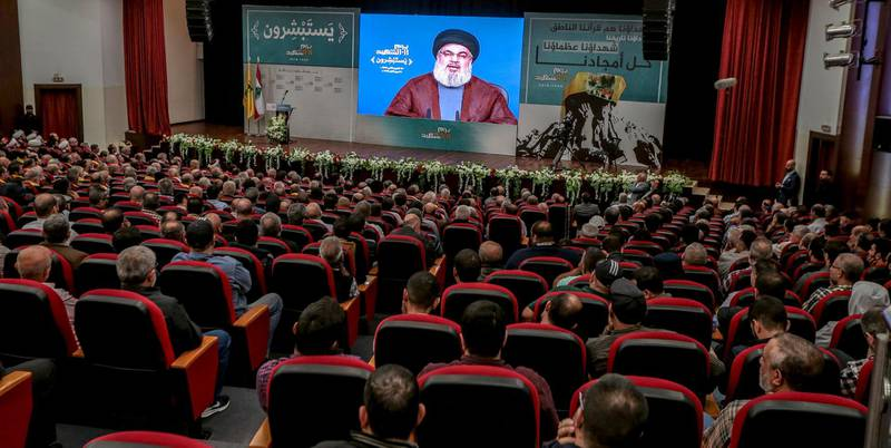 epa07155721 Lebanese supporter of Hezbollah listen to the speech of Hezbollah leader Sayyed Hassan Nasrallah on a giant screen, during a ceremony to mark the party's Martyrs Day at the hall of martyr Sayyed Mohammad Baker Al-Sadr at Al Mahdi school in Al-Hadath, southern suburb of Beirut, Lebanon, 10 November 2018. Secretary-General of Hezbollah, Sayyed Hassan Nasrallah delivered a speech, Where he talked about the political situation and the military conflicts in the Arab countries, and then touched on the Lebanese situation and political disputes between the Lebanese parties that disrupts the formation of a new government after the parliamentary elections.  EPA/NABIL MOUNZER