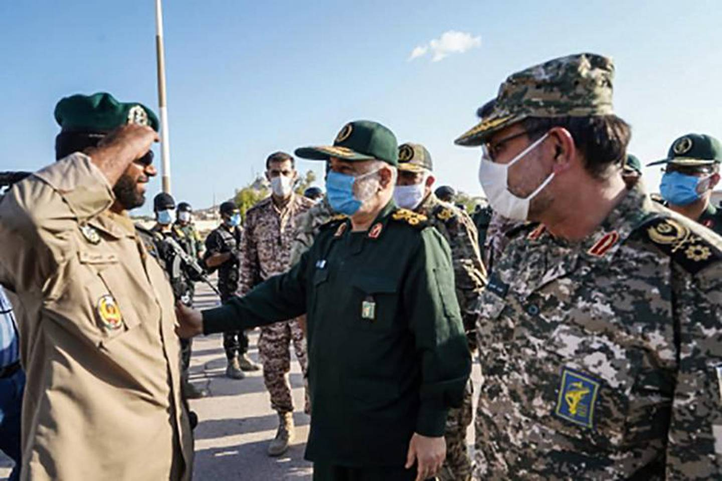 """This handout photo provided by Iran's Revolutionary Guard Corps (IRGC) official website via SEPAH News on January 2, 2021, shows Guards' chief Major General Hossein Salami (C), accompanied by Islamic Revolutionary Guard Corps navy commander Rear Admiral Alireza Tangsiri (R), inspecting troops during his visit to the island of Abu Musa, off the coast of the southern Iranian city of Bandar Lengeh facing the United Arab Emirates.  Salami vowed today to respond to any """"action the enemy takes"""" in a visit to the strategic island in the Gulf, amid rising tensions with the US,  speaking on the eve of the first anniversary of the US killing of top Iranian military commander Qasem Soleimani in a Baghdad drone strike on January 3, 2020 - XGTY / RESTRICTED TO EDITORIAL USE - MANDATORY CREDIT """"AFP PHOTO / Iran's Revolutionary Guard via SEPAH NEWS"""" - NO MARKETING - NO ADVERTISING CAMPAIGNS - DISTRIBUTED AS A SERVICE TO CLIENTS   / AFP / SEPAH NEWS / - / XGTY / RESTRICTED TO EDITORIAL USE - MANDATORY CREDIT """"AFP PHOTO / Iran's Revolutionary Guard via SEPAH NEWS"""" - NO MARKETING - NO ADVERTISING CAMPAIGNS - DISTRIBUTED AS A SERVICE TO CLIENTS"""