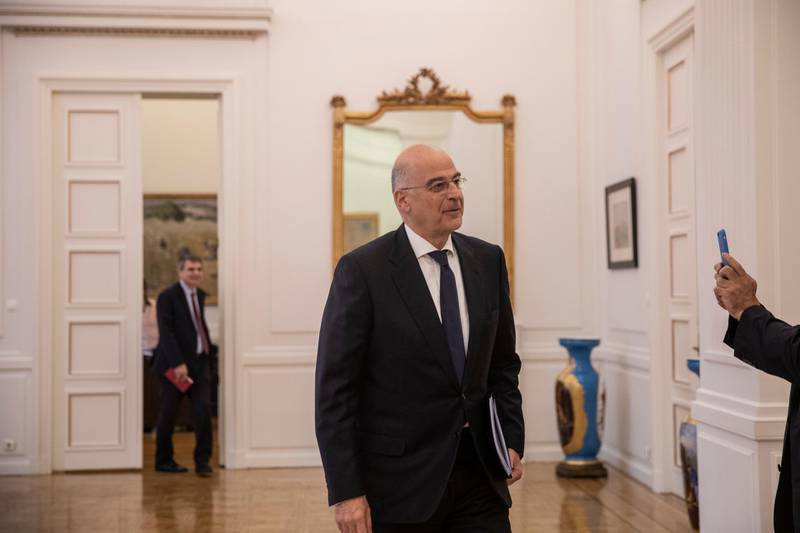 Greek foreign Minister Nikos Dendias arrive for a meeting to brief political party representatives on developments for the maritime boundary deal between Turkey and Libya in Athens, on Tuesday, Dec. 10, 2019. Greece has sent two letters to the United Nations explaining its objections to the deal and asking for the matter to be taken up by the U.N. Security Council, the government spokesman said Tuesday. (AP Photo/Petros Giannakouris)