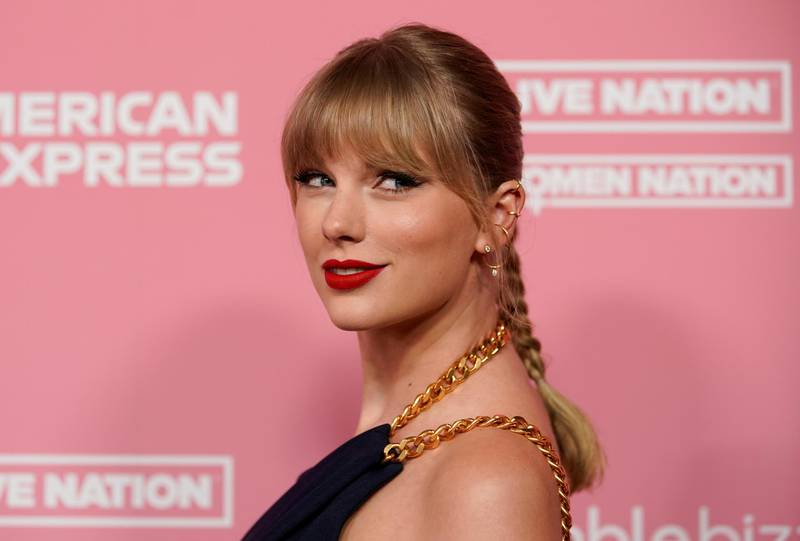 """FILE PHOTO: Singer Taylor Swift arrives on the red carpet for the """"Billboard Women in Music"""" event in Los Angeles, California, U.S., December 12, 2019.  REUTERS/Mike Blake/File Photo"""
