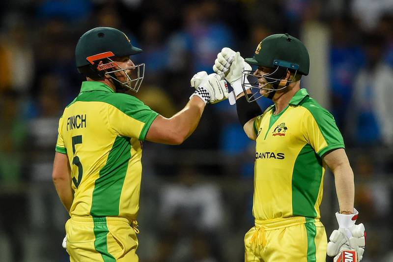 Australia's Aaron Finch (L) and teammate David Warner (R) celebrate after each scored a century (100 runs) during the first one day international (ODI) cricket match of a three-match series between India and Australia at the Wankhede Stadium in Mumbai on January 14, 2020. IMAGE RESTRICTED TO EDITORIAL USE - STRICTLY NO COMMERCIAL USE  / AFP / Punit PARANJPE                       / IMAGE RESTRICTED TO EDITORIAL USE - STRICTLY NO COMMERCIAL USE