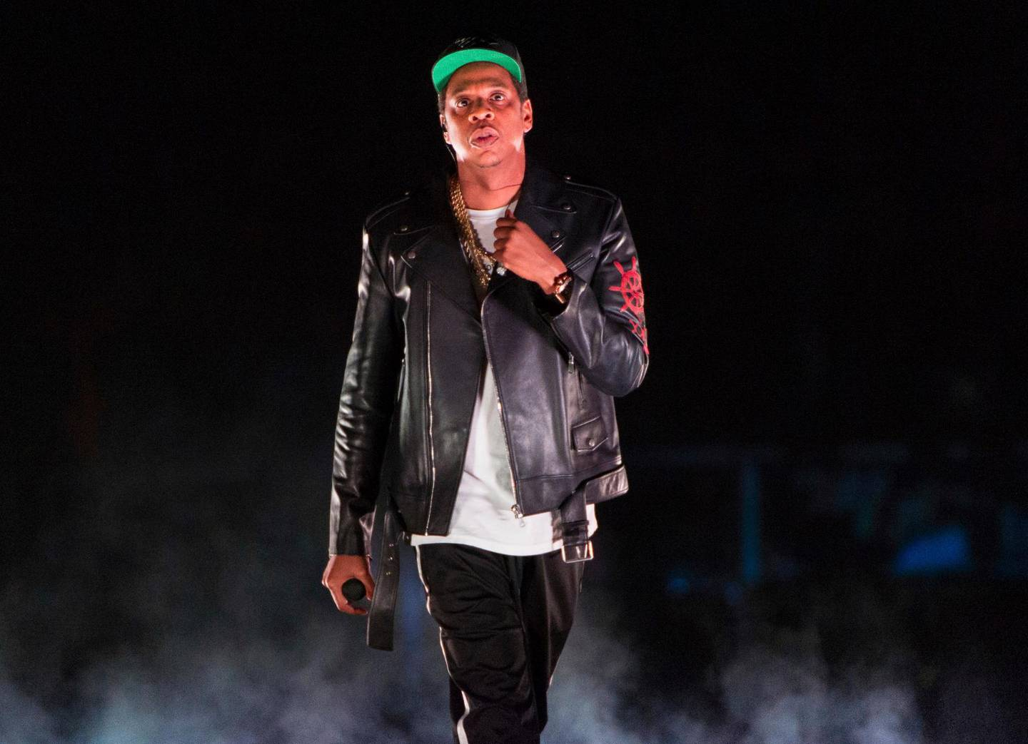 FILE - In this Nov. 26, 2017, file photo, Jay-Z performs on the 4:44 Tour at Barclays Center in New York. Woodstock co-founder Michael Lang says if he could go back in time and do things differently regarding the shambolic 50th anniversary concerts, he would. The last six months have been an extremely wild ride for Lang as he tried to make Woodstock 50 work. The first plan, to have an all-star concert with the likes of Jay-Z and more in Watkins Glen, N.Y., was scuttled after the venue pulled out. (Photo by Scott Roth/Invision/AP, File)