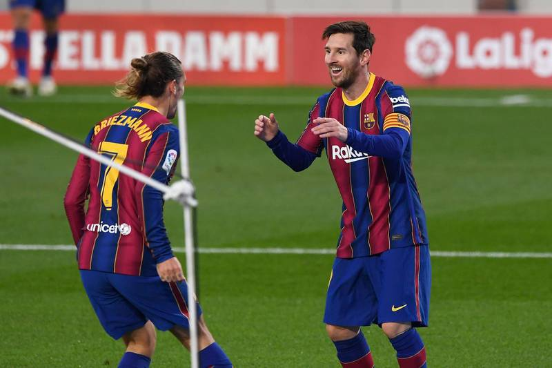 Barcelona's French midfielder Antoine Griezmann celebrates his goal with Barcelona's Argentine forward Lionel Messi during the Spanish League football match between Barcelona and Real Betis at the Camp Nou stadium in Barcelona on November 7, 2020. / AFP / Josep LAGO