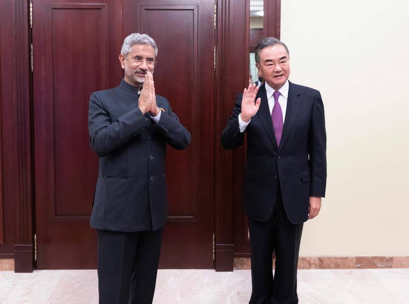 In this photo released by China's Xinhua News Agency, India's External Affairs Minister Subrahmanyam Jaishankar, left, and Chinese Foreign Minister Wang Yi pose for a photo as they meet on the sidelines of a meeting of the foreign ministers of the Shanghai Cooperation Organization (SCO) in Moscow, Russia on  Sept. 10, 2020. The Indian and Chinese foreign ministers have agreed that their troops should disengage from a tense border standoff, maintain proper distance and ease tensions in the Ladakh region where the two sides in June had their deadliest clash in decades. (Bai Xueqi/Xinhua via AP)