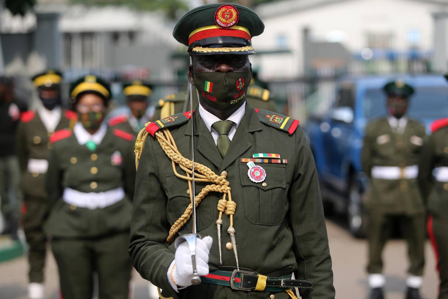 epa08939157 A military legion member wears a face mask as he stands in line during a military parade for the fallen heroes at the Tafawa Balewa military arcade in Lagos, Nigeria, 15 January 2021. The Nigerian military celebrates fallen heroes in the ceremony that includes laying of wreaths, a military parade, and gun salutes.  EPA/AKINTUNDE AKINLEYE