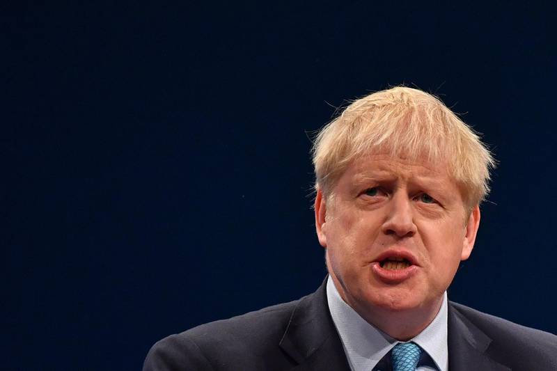 """Britain's Prime Minister Boris Johnson delivers his keynote speech to delegates on the final day of the annual Conservative Party conference at the Manchester Central convention complex, in Manchester, north-west England on October 2, 2019. Prime Minister Boris Johnson was set to unveil his plan for a new Brexit deal at his Conservative party conference Wednesday, warning the EU it is that or Britain leaves with no agreement this month. Downing Street said Johnson would give details of a """"fair and reasonable compromise"""" in his closing address to the gathering in Manchester, and would table the plans in Brussels the same day. / AFP / Ben STANSALL"""