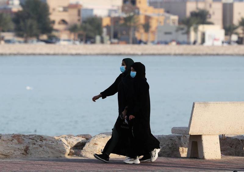 FILE PHOTO: Women wear protective face masks, as they walk, after Saudi Arabia imposed a temporary lockdown on the province of Qatif, following the spread of coronavirus, in Qatif, Saudi Arabia March 10, 2020. REUTERS/Stringer/File Photo
