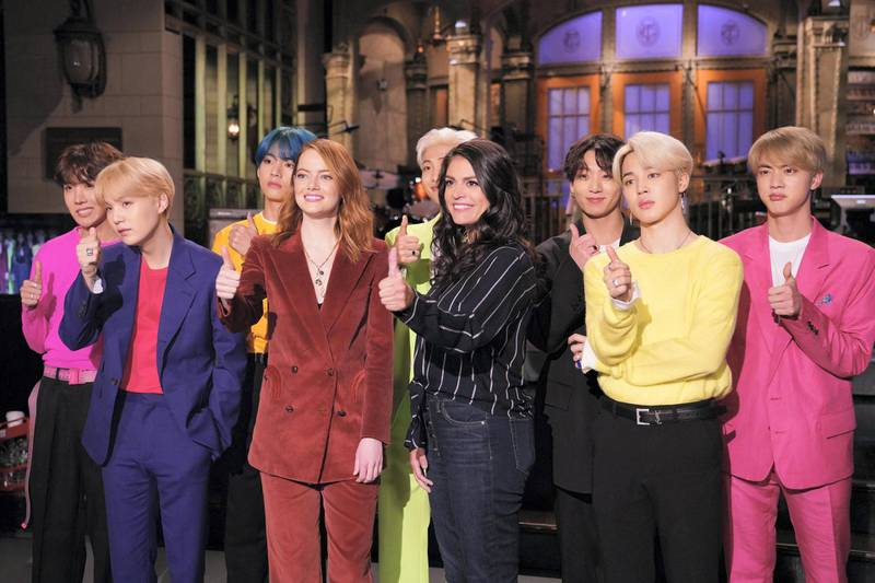 """SATURDAY NIGHT LIVE -- """"Emma Stone"""" Episode 1764 -- Pictured: (l-r) Musical guest BTS, host Emma Stone, and Cecily Strong during Promos in Studio 8H on Thursday, April 11, 2019 -- (Photo by: Rosalind O'Connor/NBC/NBCU Photo Bank via Getty Images)"""