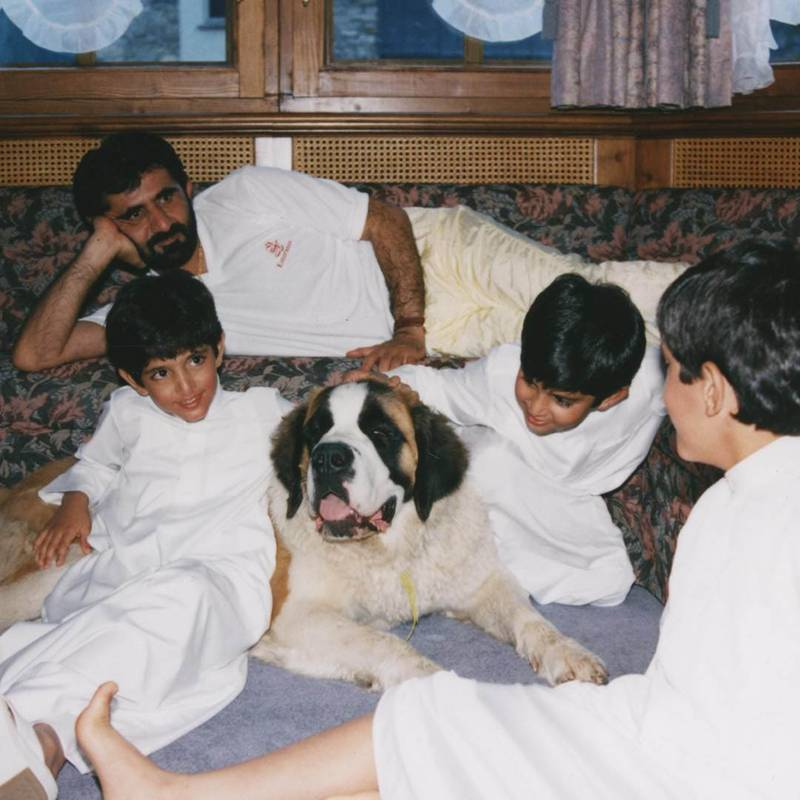 Sheikh Mohammed bin Rashid Al Maktoum is the Vice President and Prime Minister of the United Arab Emirates, and ruler of the Emirate of Dubai, with the family dog. Courtesy Sheikh Hamdan bin Mohammed bin Rashid Al Maktoum