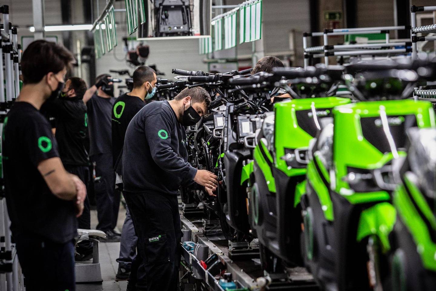 Workers install components onto S02 electric motorcycles on the assembly line at the Silence Urban Ecomobility plant in the Sant Boi de Llobregat district of Barcelona, Spain, on Wednesday, April 29, 2021. Spain plans to invest 13.2 billion euros ($15.7 billion) to boost electric vehicle use, one of a raft of measures as the government prepares to deploy European Union pandemic recovery funds to modernize the economy, Prime MinisterPedro Sanchezsaid. Photographer: Angel Garcia/Bloomberg