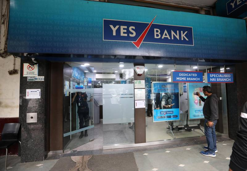 epa08274288 A person stands at a Yes Bank branch in New Delhi, India, 06 March 2020. ccording to media reports, the Reserve Bank of India (RBI) has seized control of India's Yes Bank and has caped withdrawal at 50,000 Indian rupee (678 US dollar) per account.  EPA/RAJAT GUPTA