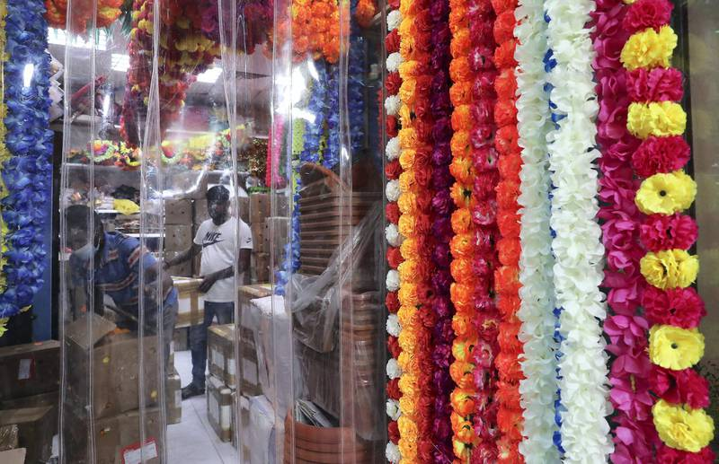 DUBAI, UNITED ARAB EMIRATES , November 1 – 2020 :- Colourful flowers and decoration items for Diwali festival on display at the shop in Bur Dubai area in Dubai. Diwali is the Indian festival of lights and this year it will be on 14th November. (Pawan Singh / The National) For News/Standalone/Online/Instagram/Big Picture