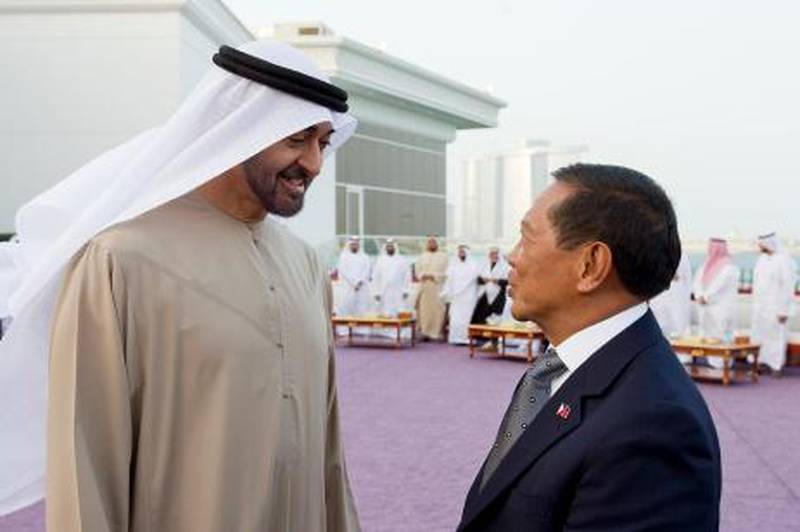 ABU DHABI, UNITED ARAB EMIRATES - January 14, 2013: HH General Sheikh Mohamed bin Zayed Al Nahyan Crown Prince of Abu Dhabi Deputy Supreme Commander of the UAE Armed Forces (L), meets with HE Jejomar Binay Vice President of the Philippines (R), during a Sea Palace majilis gathering..( Ryan Carter / Crown Prince Court - Abu Dhabi ).---