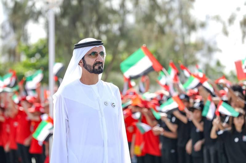 Mohammed bin Rashid raises the flag of the UAE in the Union House. WAM