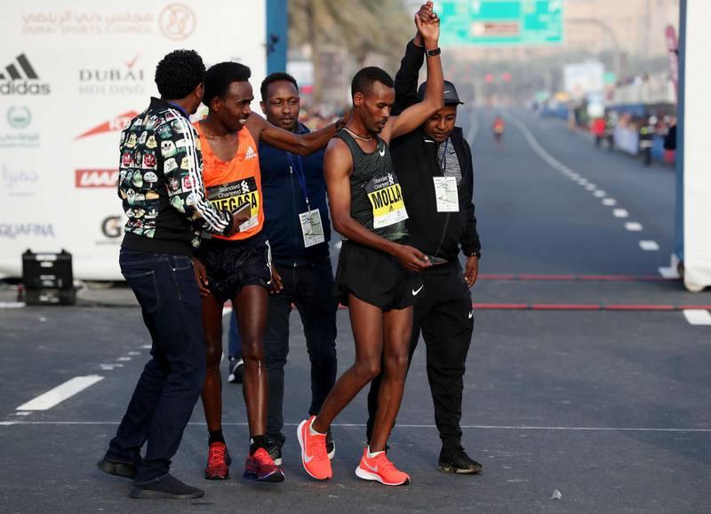 Dubai, United Arab Emirates - January 25, 2019: Getaneh Tamire Molla (R) wins the mens Standard Chartered Dubai Marathon 2019 with second place Herpassa Kitesa Negasa. Friday, January 25th, 2019 at Jumeirah, Dubai. Chris Whiteoak/The National